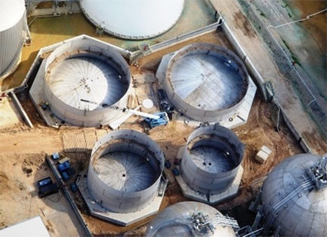 aerial view of white tanks and crane